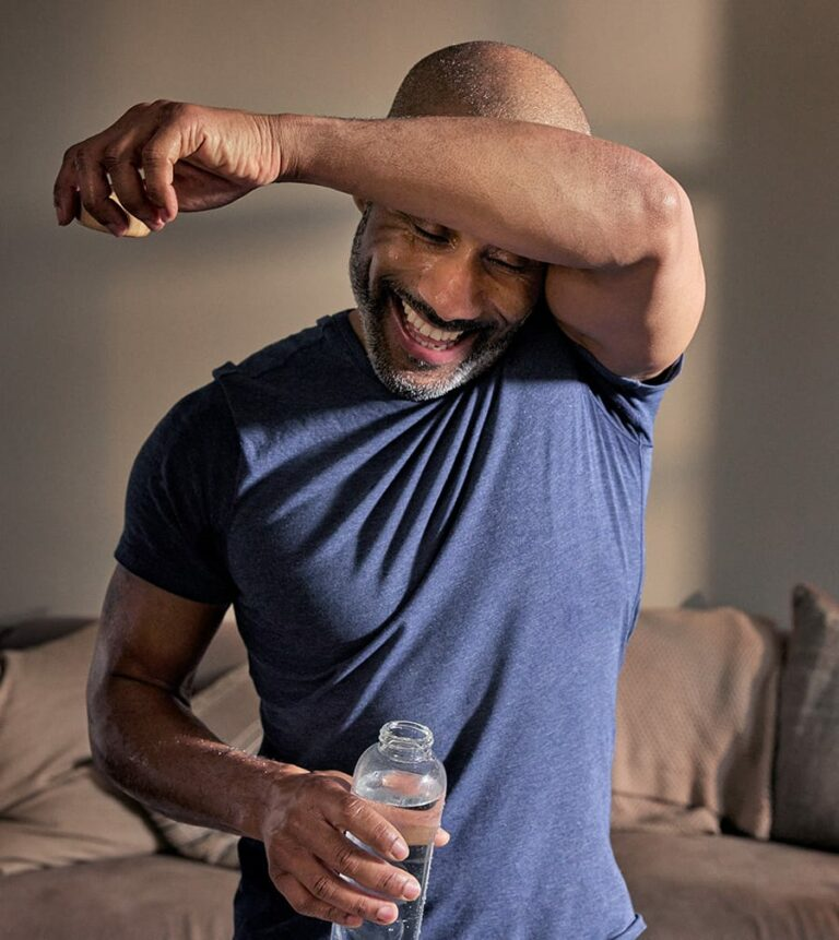 Man wiping sweat from brow
