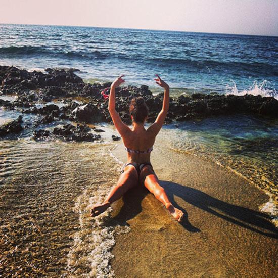 Woman doing yoga pose on beach