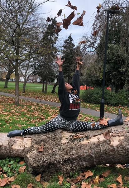 Woman doing splits on log