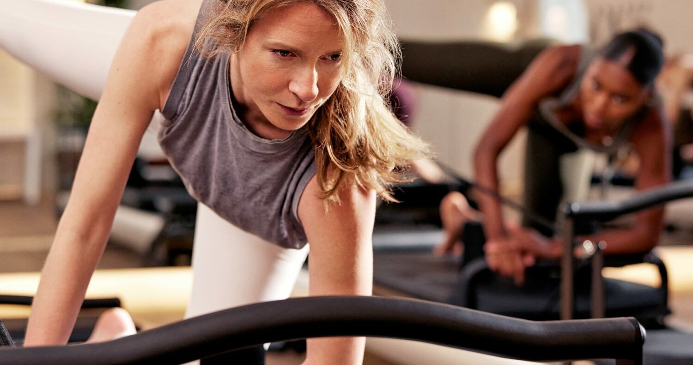 woman exercising on coreformer