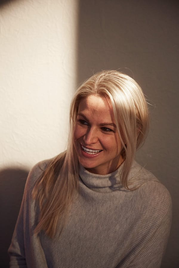Sharon Read smiling in a grey jumper