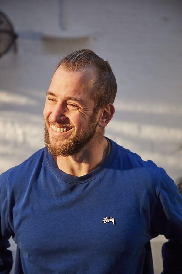Maksym Bojcun smiling in a blue tshirt