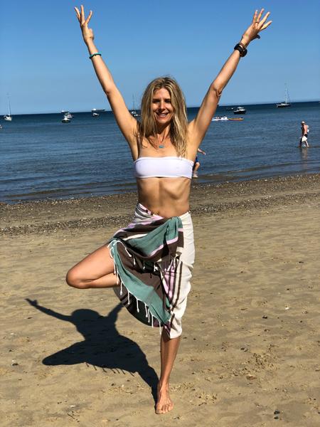 Woman in bikini and sarong on beach