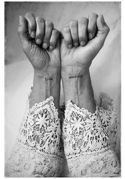 Tattoos on woman's wrist