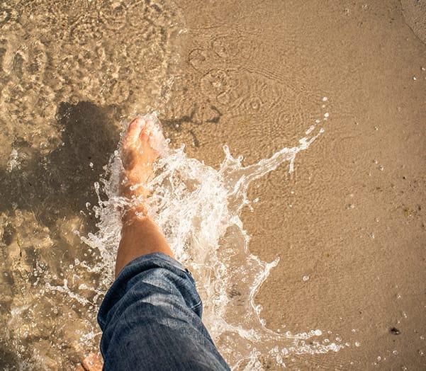 Feet in water beach