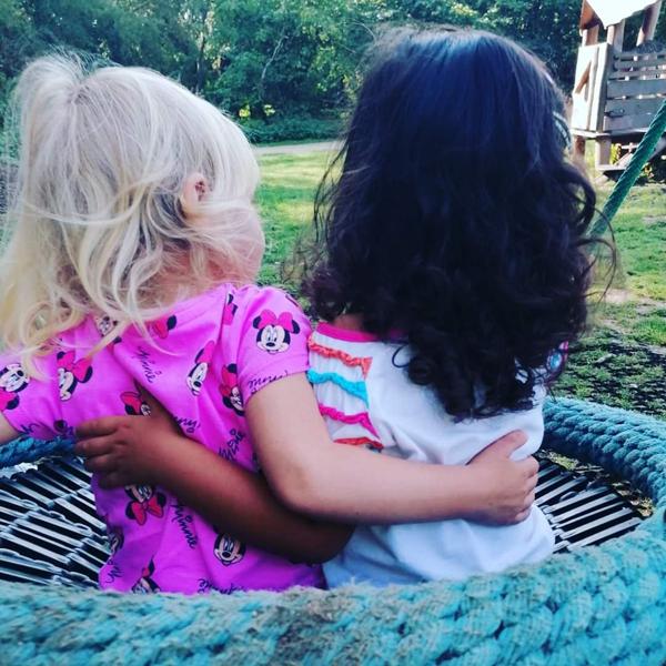 Two children hugging