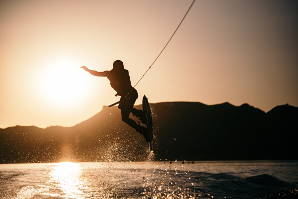 Man wakeboarding in sunset