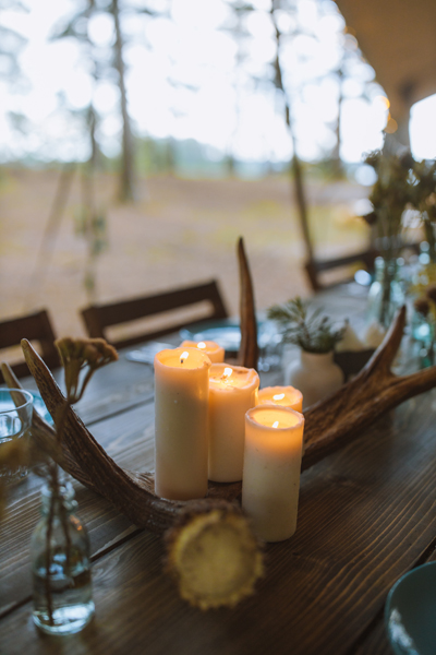 Candles on outdoor table