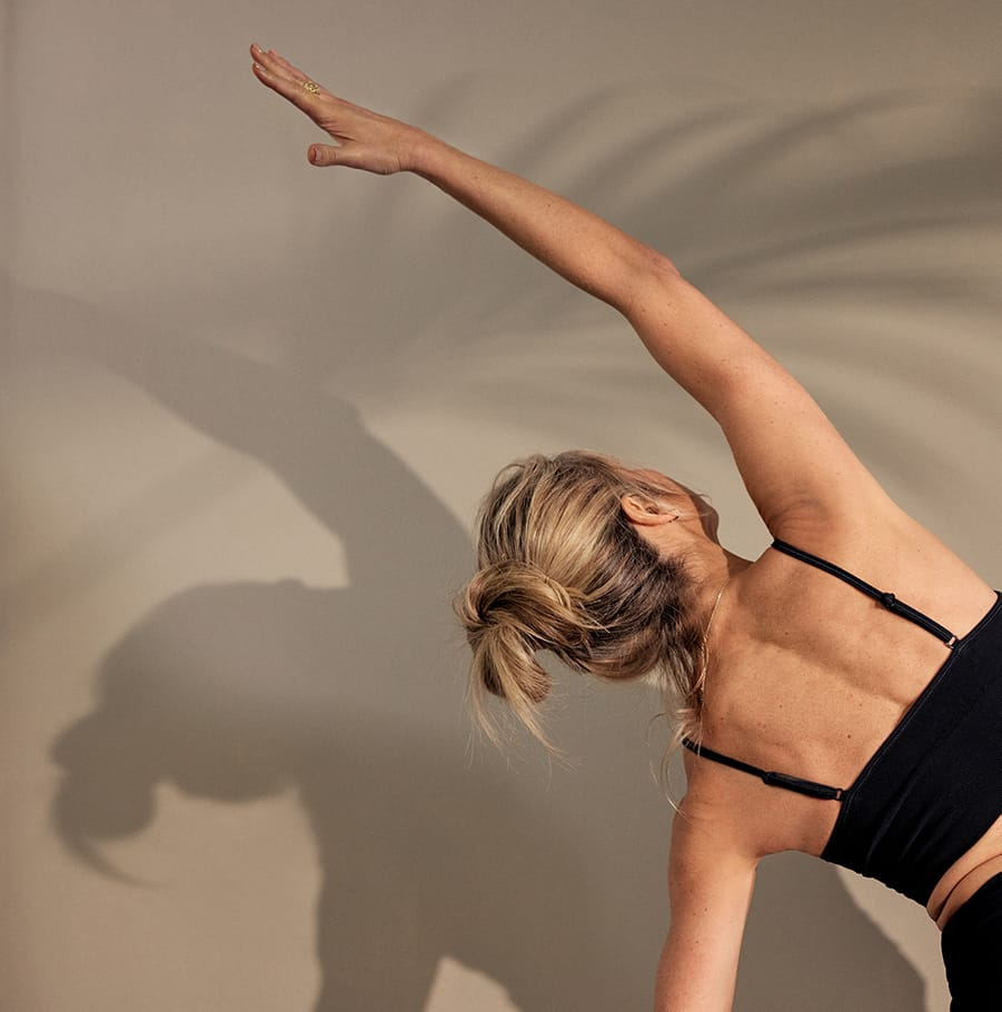 Woman stretching shadow on wall