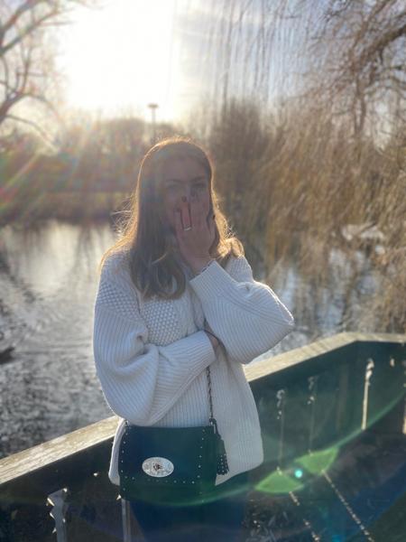 Woman in park near water