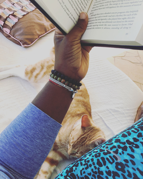 Woman reading book and cat