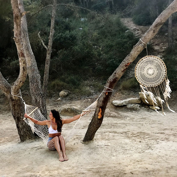Woman in hammock on beach