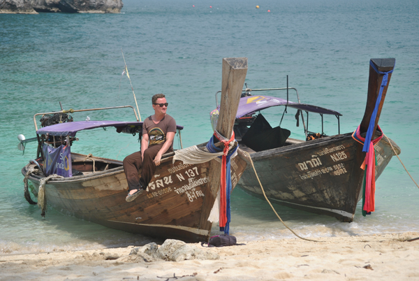 Man on boats in Asia