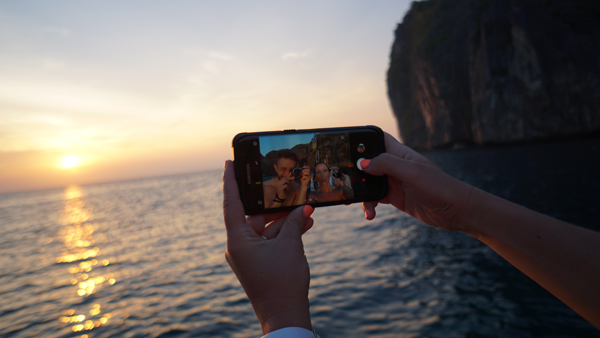 Couple taking selfie in sunset