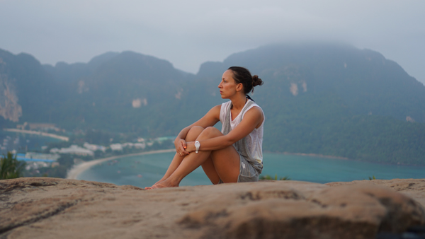 Woman on rock on coast