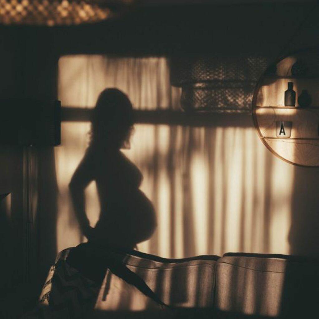 Pregnant woman's shadow